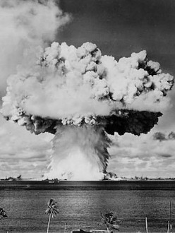 """379631 07: An atomic cloud rises July 25, 1946 during the """"Baker Day"""" blast at Bikini Island in the Pacific. (Photo by National Archive/Newsmakers)"""